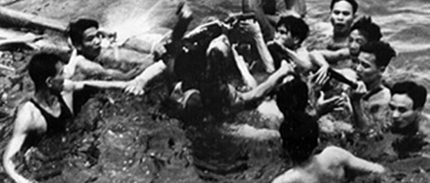 Photo released by the Vietnamese News Agency which is claimed to show the rescue on 26 October 1967 of then US navy pilot John McCain, centre, from Hanoi's Truc Bach lake.