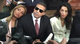 Mohammad Fahmy, his wife on the left, his lawyer Amal Clooney on the right.