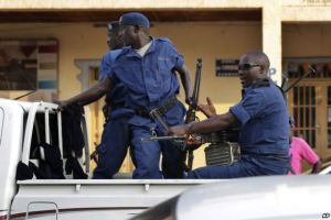 Brundi - Police Bujumbura, Burundi - Police drive by the scene of a grenade attack on a parked car downtown Bujumbura, July 20, 2015