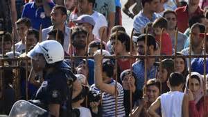 Greece youth refugees beaten and tear gassed.