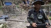 A cage made of barbed wire and bamboo sticks that Malaysian police said was used to hold migrants is seen at the abandoned human trafficking camp in the jungle close the Thailand border at Bukit Wang Burma in northern Malaysia. (Damir Sagolj/Reuters)