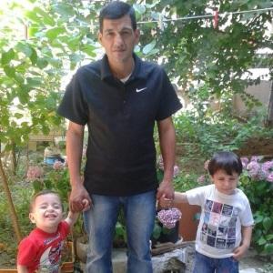 Abdullah Kurdi with his sons