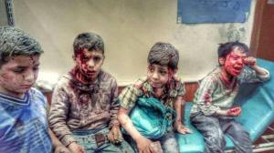 four children sitting in rubble