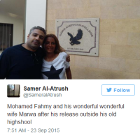 Mohamed Fahmy hugs his wife Marwa Omara after being released from Torah prison in Cairo, Egypt, Wednesday