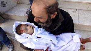 Father holding his dead baby