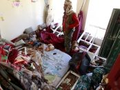 A Yemeni man inspects the damage in his house following air strikes carried out by the Saudi-led coalition in the capital Sanaa. AFP