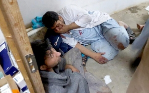 Medecins Sans Frontier tweeted this picture of a member of their staff in shock in one of the remaining parts of their hospital in Kunduz (Photo Courtesy MSF)