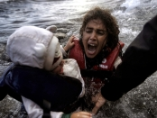 A woman falls into the water with her child