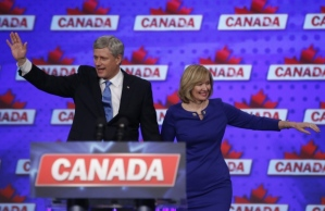 Stephen Harper and his wife, Laureen, greet supporters in the Calgary Heritage riding prior to the Conservative leader conceding defeat. (Jeff McIntosh/Canadian Press)