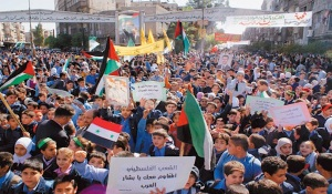 "The Syrian uprising began with protests held in early 2011, demanding release of political prisoners. In March 2011, security forces opened fire on protesters at a ""Day of Rage"" rally in the southern city of Deraa, triggering days of violent unrest and more civilian deaths."
