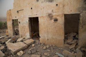 The remains of the home of Omar Ali Farjain, hit by an airstrike on May 12, 2015. Minutes earlier, another bomb struck Abs/Kholan Prison across the street. The two attacks killed at least 25 civilians.