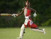 A Maasai Warriors cricket team batsman wearing traditional robes and cricket pads. (Photo: Heavy Soul Films)