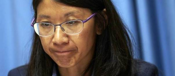 Joanne Liu, president of Medecins Sans Frontieres (MSF) International, pauses before making her statement in Geneva, Switzerland, October 7, 2015. MSF said it demands an international fact finding commission into the deadly U.S. bombing of its hospital in the Afghan city of Kunduz at the weekend under the Geneva Conventions. REUTERS/Denis Balibouse