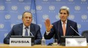 Russia's Foreign Minister Lavrov listens to U.S. Secretary of State Kerry during a press conference at the United Nations Headquarters in Manhattan, New York