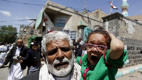 At least 126 people have been killed, medical sources say, and scores more wounded at two mosques attended by primarily Shi'ite Houthi Muslims in Sana'a.