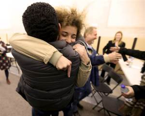 Anas Francis reunites with his cousin Laila Beylouneh, a 13-year-old Syrian refugee, at the Welcome Center in Montreal, Canada on Dec. 12, 2015