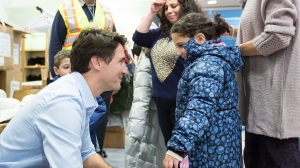 Prime Minister Justin Trudeau welcomes Syrian refugees to Canada late Thursday night at Pearson International airport