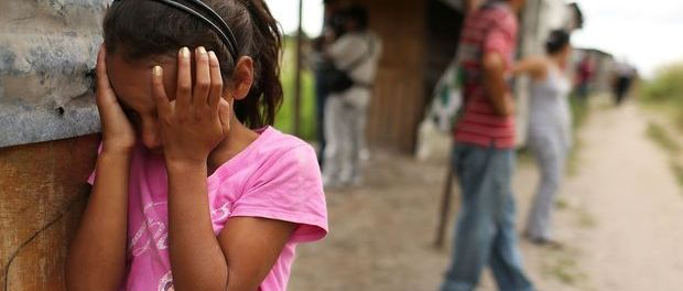 Refugee-girl-cries-as-her-Central-American-shanty-town-is-destroyed-0714-by-Spencer-Platt