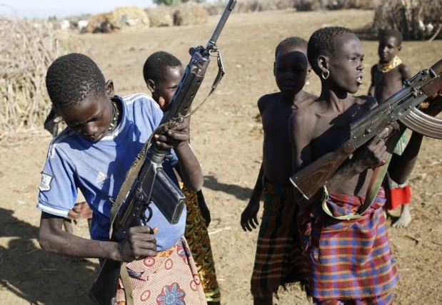 Rebel child soldiers gather in Gumuruk, as they prepare to handover their weapons at a demobilisation ceremony in Jonglei State, eastern South Sudan, January 27, 2015. REUTERS/KATY MIGIRO