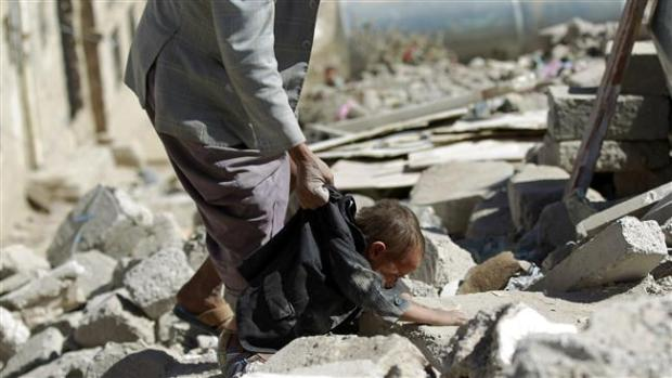 A Yemeni searches for survivors under the rubble of houses destroyed by an overnight Saudi air strike on a residential area in Yemen's capital, Sanaa, on May 1, 2015.