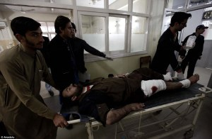 Rescuers move an injured victim at a hospital following an attack by gunmen in the Bacha Khan university in Charsadda, about 50 kilometres from Peshawar, which has left at least 21 people dead and dozens wounded. (Photo: Daily Mail Online). AlistairReignBlog.com