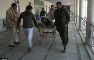 An injured man is taken to a hospital in Charsadda, in northwestern Khyber Pakhtunkhwa province. (Photo: Daily Mail Online). AlistairReignBlog.com