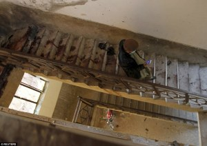 A man walks down the blood-stained stairs leading down from the roof of a dormitory where the militant attack took place. (Photo: Daily Mail Online). AlistairReignBlog.com