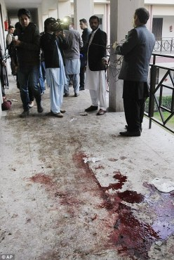 Taliban gunmen stormed the school near the city of Peshawar, leaving dozens dead and injured in pools of blood across the campus. (Photo: Daily Mail Online). AlistairReignBlog.com