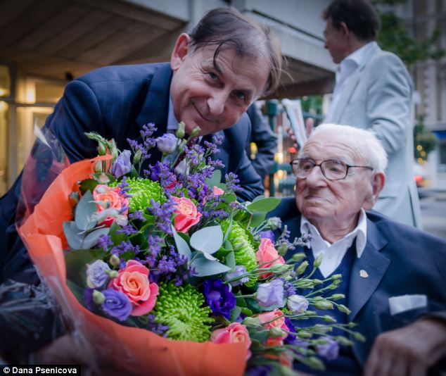 Sir Nicholas was presented with a beautiful home-made birthday cake with 105 candles and a bouquet of flowers. (Credit: Daily Mail UK). (Alistair Reign News Blog: www.AlistairReignBlog.com).