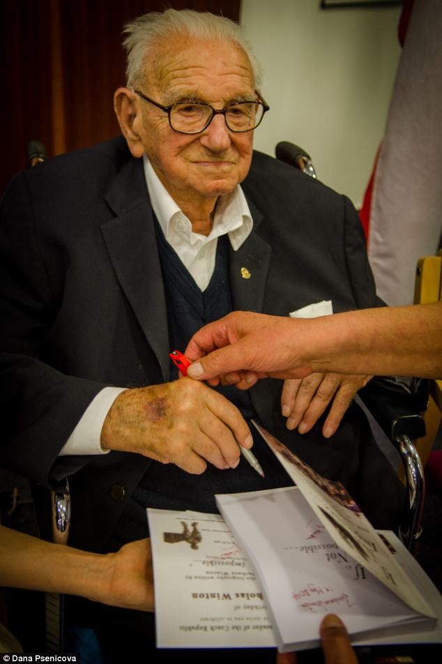 Sir Nicholas Winton signing a copy of a new book about his life called If It's Not Impossible written by his daughter Barbara Winton. (Credit: Daily Mail UK). - (Alistair Reign News Blog: www.AlistairReignBlog.com).