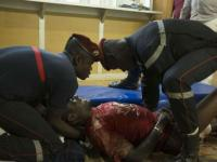 Paramedics tend to a wounded man in the surrounding of the hotel Splendide and the cafe Cappuccino during the attack on January 15, 2016.