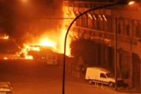 Vehicles on fire outside the Splendid Hotel in Ouagadougou, capital of Burkina Faso, after it was attacked by Al Qaeda militants on the night of January 15, 2016. Reuters TV / Reuters