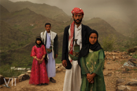 Tahani, 8, is seen with her husband Majed, 27, and her former classmate Ghada, 8, and her husband, outside their home in Hajjah, Yemen. 26 July, 2010. Photo Credit: © Stephanie Sinclair/VII/Tooyoungtowed.org