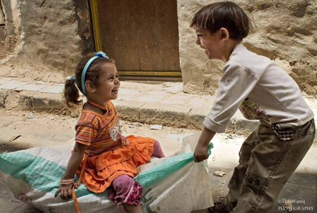 An image of playful kids taken in the old Sana'a. We teach life (Photo/ quote: Thana Faroq).
