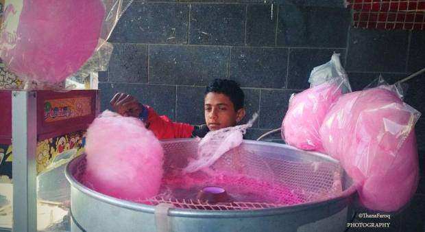 "The strangest thing I've ever heard about a cotton candy: "" Would you like one, it's good for the hair & skin!! "" This kid is one of the real warriors. He's always there near Alkumim center in spite of the escalating conflict with a fighting spirit and great marketing skills:)"