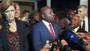 Burundi's President Pierre Nkurunziza, center, and U.S. ambassador to the U.N. Samantha Power, left, speak to the media in Gitega, Burundi, Jan. 22, 2016.