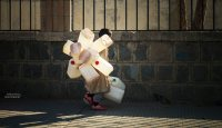 Yemen: Child carrying empty containers on his journey to find water. (Photo: Thana Faroq).