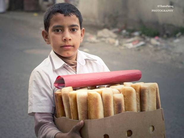 For this kid to carry bread under this hard conditions has become a sign of life and hope for those who see him.