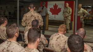 Harjit Sajjan answers questions from Canadian Armed Forces members deployed on Operation IMPACT