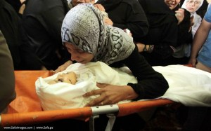 A Mother in Yemen Weeps Over Her Dead Child, who was killed in an airstrike in her village.