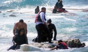 Greek islander Antonis Deligiorgis, left, pulls an Eritrean woman, Wegasi Nebiat, from the sea off Rhodes last year. (Photo: Argiris Mantikos/ AP).