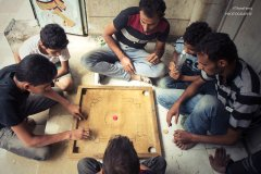 Young people play a game on Jamal Street in Sanaa on June 15, 2015. (Photo/ quote: Thana Faroq).