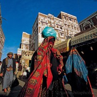 Though many women in Yemen shroud themselves completely in black, colorful head scarves and veils (sitara) are often seen in the markets. (Photo/credit: National Geographic).