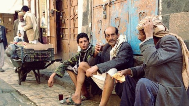 "Three men sit in the old city of Sanaa on April 19, 2015. ""œWe are enjoying our cup of tea under the melody of those stupid jets hovering all over,"" one says. (Photo/ quote: Thana Faroq)."