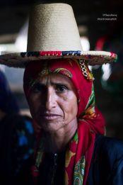 "Yemen woman in bright scarf and hat, ""War humiliated my daughter."" Aunt Khemissa argument."