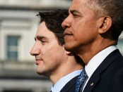 The two leaders listen to the Canadian national anthem during a state arrival ceremony on the Whitehouse lawn. March 10, 2016.