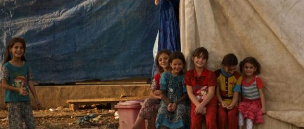 Children gather together in a refugee camp in Iraq. (Photo: Amy McTighe).
