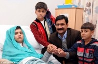 Pakistani schoolgirl Malala Yousafzai, pictured with her brothers and father, is recovering after surgery to remove the bullet at a hospital in Birmingham. (Photo: Daily Mail). Her father an activist for education in Pakistan and battling against the Taliban's decision for education against girls. Both Malala and her father Ziauddin Yousafzai shared a passion for education and a love for learning.