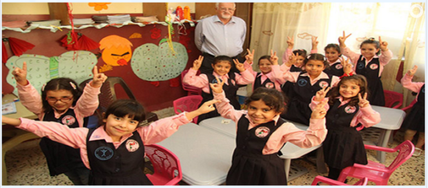 Children and their teacher inside a school for refugees in Syria, built by Humanity First. (Photo: HF).