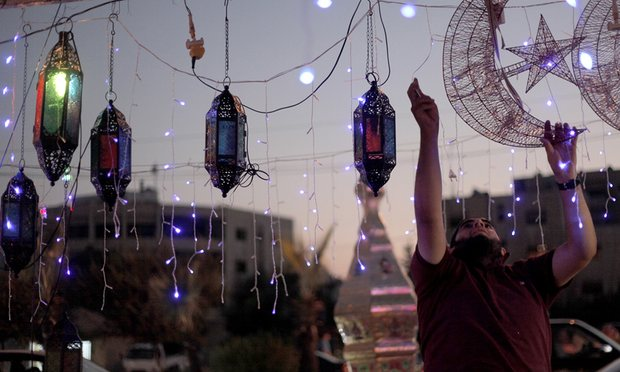A street vendor plugs in decorations for Ramadan in Amman, Jordan. Photograph: Mohammad Hannon/AP